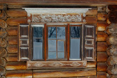 Rustic ornate window. On front of brown old timber house Royalty Free Stock Photography