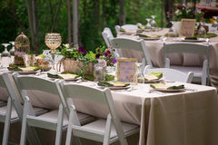 Rustic Outdoor Table Setting for Wedding Reception. Using chic and vintage items Royalty Free Stock Photo