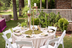 Rustic Outdoor Table Setting for Wedding Reception. Using chic and vintage items Royalty Free Stock Image