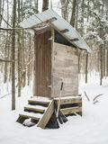 Outdoors primitive privy or outhouse Royalty Free Stock Image