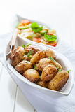 Rustic oven baked potatoes Royalty Free Stock Photos