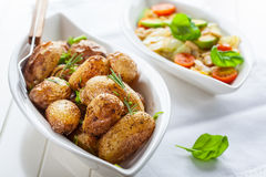 Rustic oven baked potatoes Royalty Free Stock Images