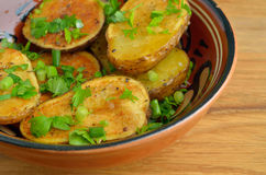 Rustic oven baked potatoes Stock Photos