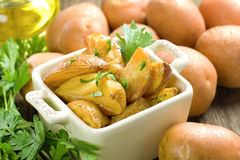 Rustic oven baked potatoes with parsley Stock Photos