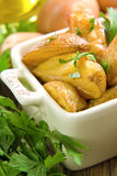 Rustic oven baked potatoes with parsley Stock Photo