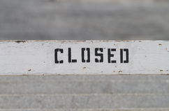 Rustic painted CLOSED sign on wood Stock Photo