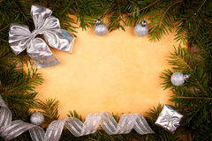 Rustic paper with silver Christmas decorations Royalty Free Stock Photos