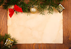 Rustic paper with small Christmas decorations Stock Images