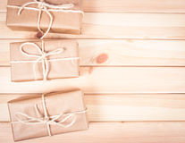 Rustic parcels gift box with kraft paper. Stock Images