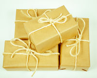 Rustic parcels gift box with kraft paper. Stock Photos