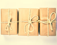 Rustic parcels gift box with kraft paper. royalty free stock photos