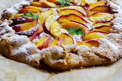 Rustic peach pie Stock Image