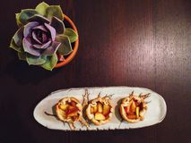 Rustic peach tarts. Displayed on autumn themed pottery Stock Photo