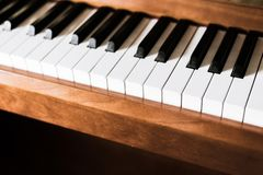 Rustic piano: close up picture of classical piano keys, selective focus. Rustic piano keys, close up picture. Classical instrument vintage jazz keyboard lesson stock photography