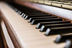 Rustic piano: close up picture of classical piano keys, selective focus. Rustic piano keys, close up picture. Classical instrument vintage jazz keyboard lesson royalty free stock photography