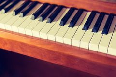 Rustic piano: close up picture of classical piano keys, selective focus. Rustic piano keys, close up picture. Classical instrument vintage jazz keyboard lesson stock photos