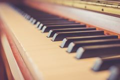 Rustic piano: close up picture of classical piano keys, selective focus. Rustic piano keys, close up picture. Classical instrument vintage jazz keyboard lesson royalty free stock images
