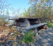 A rustic picnic bench in the yukon territories Stock Photos