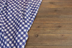 Rustic Picnic Wooden Table With Blue Folded Checkered Tablecloth. Top View, Copy Space Royalty Free Stock Images