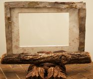 Rustic picture frame. A rustic picture frame made of wood and bark sitting on copper tiles. I make all of my rustic frames and mats royalty free stock photography