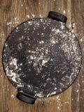 Rustic pizza baking stone utensil Stock Images