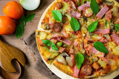 Rustic pizza with becon, salami, mozzarella and basil. Top view royalty free stock photos