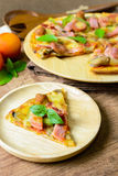 Rustic pizza with becon, salami, mozzarella and basil. On wooden table stock images
