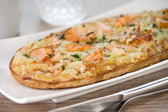Rustic pizza bread with salmon and cheese Stock Photos