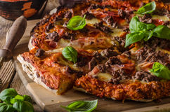 Rustic pizza with minced meat Royalty Free Stock Photography