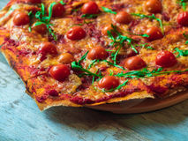 Rustic pizza with mozzarella, basil and cherry tomatoes. Rustic pizza with mozzarella, basil and cherry tomatoes stock images