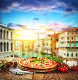 Rustic pizza with old city Italy background Royalty Free Stock Photos