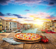 Rustic pizza with old city Italy background Stock Image