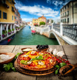 Rustic pizza with old city Italy background Royalty Free Stock Image