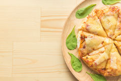 Rustic pizza on wooden background. Top view Royalty Free Stock Images