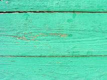 Rustic plank background of green and turquoise, weathered texture with copy space. Green empty wooden background.  Old dirty wall. Rustic plank background of stock photography