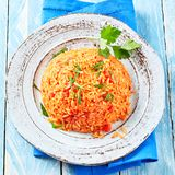 Rustic plate of tasty savory Greek tomato rice royalty free stock image