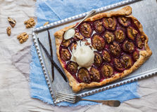 Rustic plum pie with walnuts and ice-cream Royalty Free Stock Photo
