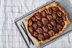 Rustic plum pie with walnuts Stock Photo