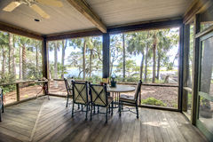 Rustic porch with forest and waterfront view Royalty Free Stock Photography