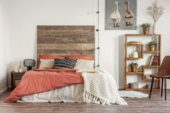 Free Rustic Poster With Two Ducks, Wooden Bookshelf And Double Bed With Pillows And Duvet Stock Photos - 152848733