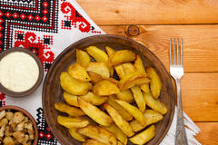 Rustic potatoes with bacon and sauce Royalty Free Stock Photos