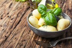 Rustic boiled potatoes. Rustic potatoes boiled with a bunch of fresh basil.Russian food Stock Image