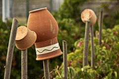 Rustic pottery jugs, pots hanging on the fence Stock Photography