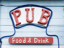 A rustic pub sign. Showing that the place does food and drinks Stock Photography