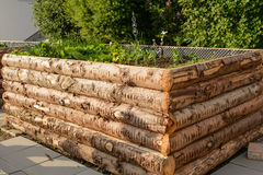 Rustic raised bed made of logs Royalty Free Stock Photo
