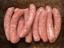 Rustic raw uncooked sausages Royalty Free Stock Photography