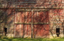 Rustic red barn doors. royalty free stock image