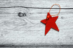 Rustic red Christmas star background. On old weathered wooden boards with woodgrain texture and copyspace for your seasonal greeting stock image