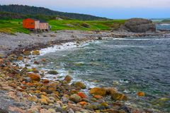 Cod Fishing Shanties at Broom Point, Gros Morne National Park, Newfoundland, Canada. Only rustic red cod fishing shanties remain to mark the historic cod stock images