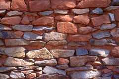 Rustic red stone wall Stock Photography